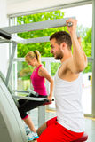 People in sport gym on the fitness machine Royalty Free Stock Images