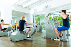 People in sport gym on machines Stock Image
