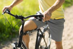 Close up of man riding bicycle outdoors. People, sport and lifestyle concept - close up of young man riding bicycle outdoors royalty free stock image