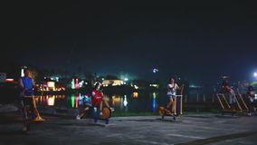 Thailand, Koh Samui, 14 december 2015. People sport training outdoor in the park in the evening at lake. 1920x1080. People sport training outdoor in the park in stock video