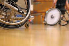 People in a sport wheelchair in a gym Royalty Free Stock Photo