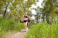 People in sportswear jogging Stock Photos