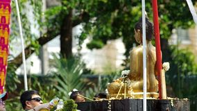 People spray holy water to the Buddha. Chiang Mai, Thailand - APRIL 13, 2015: people spray holy water to the Buddha statue on Songkran day April 13, 2015 in stock video