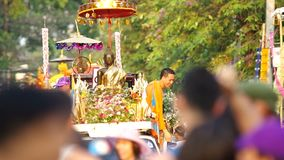 People spray holy water to the Buddha statue stock video footage