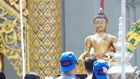 People spray holy water to the Buddha statue. Chiang Mai, Thailand - APRIL 13, 2015: people are spray holy water to the Buddha statue on Songkran day April 13 stock video footage