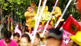 People spray holy water to the Buddha statue in parade stock footage