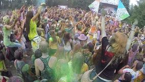 People spraying colored powder paint at festival, slow motion. Stock footage stock video footage