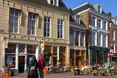 People with Spring fever on terrace city Leeuwarden. Netherlands province of Friesland, Leeuwarden city: right in the center of the town there are people in the Royalty Free Stock Image