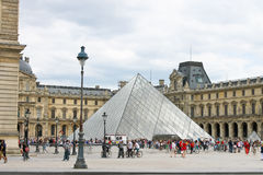 People in the square in front of the Louvre Stock Photos