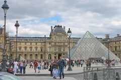 People in the square in front of the Louvre Royalty Free Stock Image