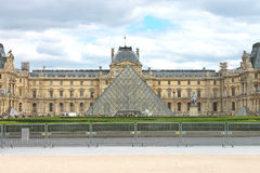 People in square in front of Louvre. Stock Photo