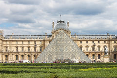 People in square in front of Louvre. Royalty Free Stock Photography