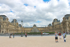 People in square in front of Louvre. Stock Image