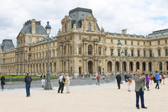People in square in front of Louvre. Stock Photography