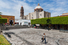 People in a square in the historic center of the city of San Miguel de Allende, Mexico. Stock Images