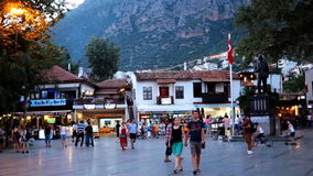 People on the square of Kas, Turkey in evening stock video