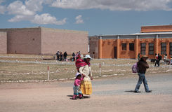 People at the square of Tiwanaku site, Bolivia Royalty Free Stock Photography