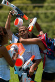 People Squirt One Another In Group Water Gun Fight Royalty Free Stock Photography