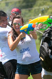 People Squirting Others In Water Gun Fight stock images