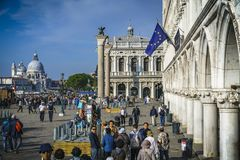 People on the st marks square in front of the doges palace in ve. Many people on the st marks square in front of the doges palace in venice, italy Stock Photography