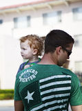 People at St Patricks Day Parade. SAN DIEGO, CA, USA – MARCH 16, 2013: Father and son at St. Patricks Day Parade and Festival on March 16, 2013 San Diego, CA Royalty Free Stock Photography