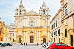 People at St Paul Cathedral in Mdina in Malta. Mdina, Malta - April 4, 2014: People at St Paul Cathedral in Mdina in Malta Island Stock Photos