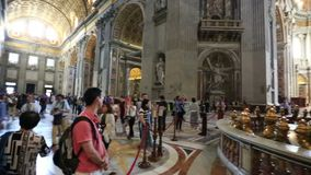 The people in St. Peter`s Basilica, Vatican city. Worshippers and tourists in St. Peter`s Basilica in Vatican city, Rome, Italy stock footage