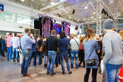 People by stage. People standing in front of a stage with a presentation at a wedding fair in Poznan, Poland stock photography