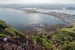 People at stairs at the Seongsan Ilchulbong Peak Royalty Free Stock Image