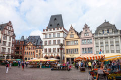 People and stalls at Market square in Trie Stock Image
