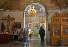 People stand on church service in Church of the Assumption. Poshekhonje, Yaroslavl region.  stock photos