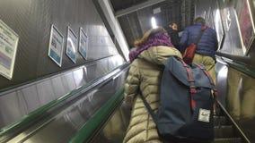 People stand on escalator in Toyama train station, Japan. People standing on escalator in Toyama train station, Japan stock footage