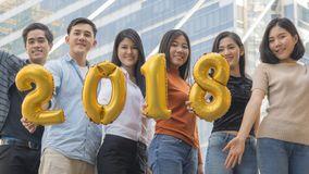 People stand in feeling happy with number balloon 2018. The people stand in feeling happy with number balloon 2018 stock photos