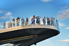 People stand on a glass bridge in Zaryadye park in Moscow. Popular landmark. Stock Photo