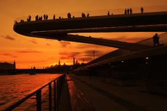 People stand on a glass bridge in Zaryadye park in Moscow. Popular landmark. Stock Images