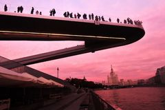 People stand on a glass bridge in Zaryadye park in Moscow. Popular landmark. Stock Photography