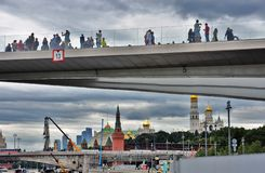People stand on a glass bridge. Zaryadye park in Moscow. royalty free stock photos