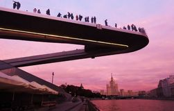 People stand on a glass bridge in Zaryadye park in Moscow. Popular landmark. Royalty Free Stock Photo