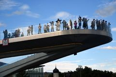 People stand on a glass bridge in Zaryadye park in Moscow. Popular landmark. Royalty Free Stock Photos