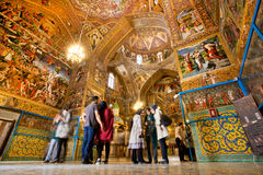People stand inside the armenian сathedral with magical paints Royalty Free Stock Images