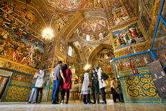 People stand inside the Cathedral with magical paints and fresco. Stock Images