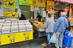 People stand in line for olives on Mahane Yehuda market in Jerus. JERUSALEM, ISRAEL - DECEMBER 26, 2016:  People stand in line for olives on Mahane Yehuda market Stock Photos