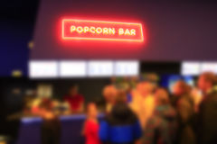 People stand in line for popcorn Stock Photography