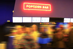 People stand in line for popcorn Royalty Free Stock Image