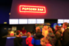 People stand in line for popcorn Royalty Free Stock Images
