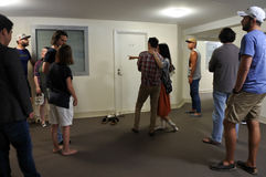 People stand in line to view a apartment for rent Stock Images