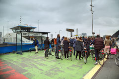 People stand in the queue for the ferry across the river in Amsterdam, The Netherlands. Royalty Free Stock Photo