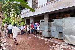 People stand in a queue to alcoholic shop. Varkala Royalty Free Stock Photography