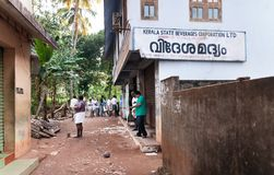 People stand in a queue to alcoholic shop. Varkala Stock Photography
