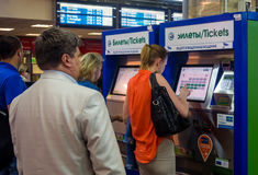 People stand in a queue to the terminals on the automated ticket Kursk station the city of Moscow. Moscow, Russia - June 15, 2016: People stand in a queue to the stock photo